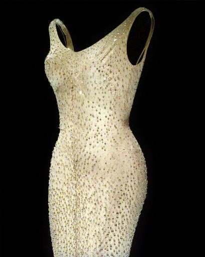 """FILE- This Friday, Oct. 22, 1999 file photo shows Marilyn Monroe's """"Happy Birthday, Mr. President"""" dress on display at Christie's in New York. Julien's Auctions says that the iconic, form-fitting gown was sold for $4.8 million Thursday, Nov. 17, 2016, to Ripley's Believe It or Not. (AP Photo/Bebeto Matthews, FILE)"""