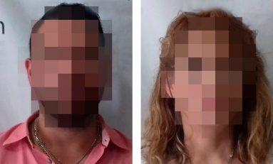 Detienen a pareja que intentó hacer fraude en banco
